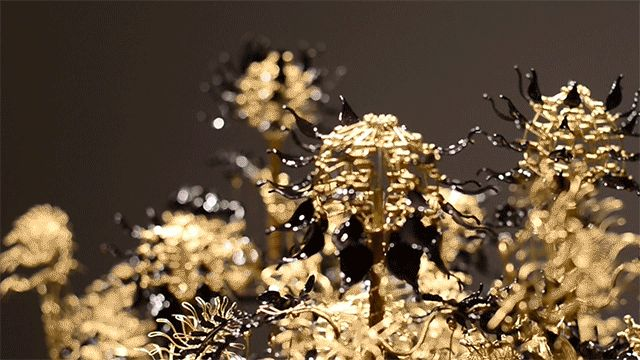 Seattle-based artist Casey Curran constructs elaborate kinetic sculptures primarily of brass wire that twist, bloom, flip, or wiggle depending on the subject. Some pieces rely on a motorized mechanism, but most of his artworks function with the help of a single hand crank that brings the piece to li