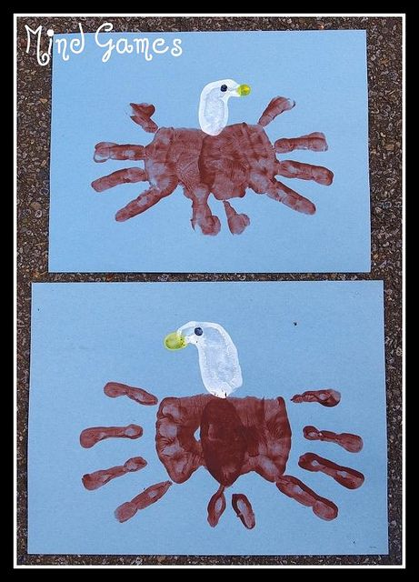 Two brown hands, thumbs together and fingers spread out, became the eagle's body.  For the head we painted the pinkie side of a closed fist white.  A yellow thumbprint made the beaks and a black pinkie tip dot was the eye.