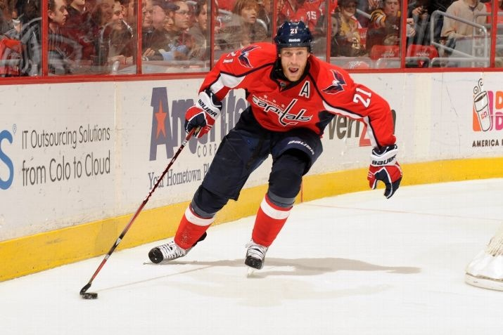 WASHINGTON, DC - JANUARY 24: Brocks Laich #21 of the Washington Capitals skates with the puck during an NHL hockey game against the Boston Bruins on January 24, 2012 at the Verizon Center in Washington, DC. (Photo by Mitchell Layton/NHLI via Getty Images)