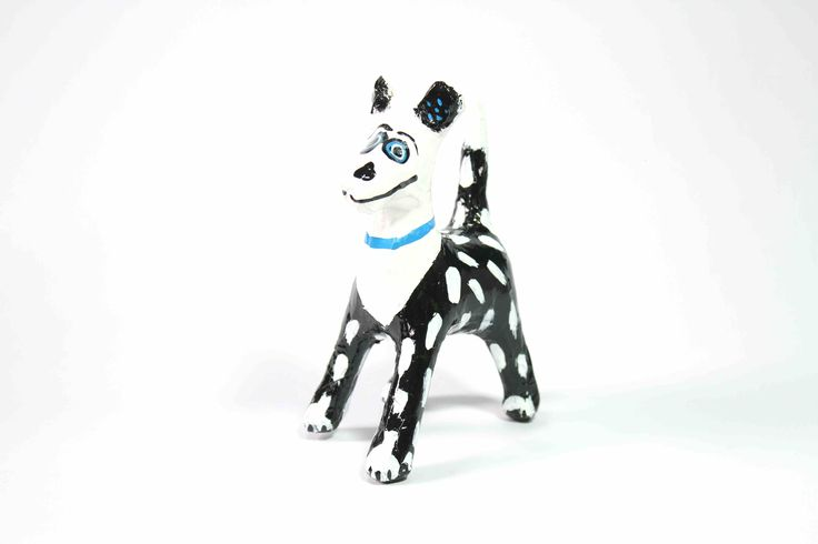 Papier-Mache Spotty Dog (Black & White): This handcrafted papier-mache dog was made using recycled newspaper.  Each one is hand painted making them all unique and individual.  It is sure to add colour and happiness to the room.