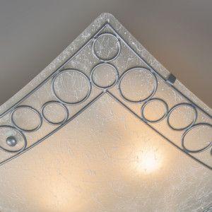 Plafón TITAN cuadrado con cristal - Lámpara de techo cuadrada, ligeramente curvada con un borde de filigranas metálicas de acero. El vidrio esta tratado especialemente, hecho que da una apariencia muy especial.