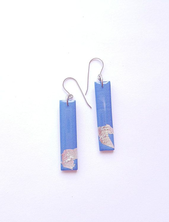 Check out this item in my Etsy shop https://www.etsy.com/ca/listing/587121736/blue-shrimmer-dangle-bar-earrings