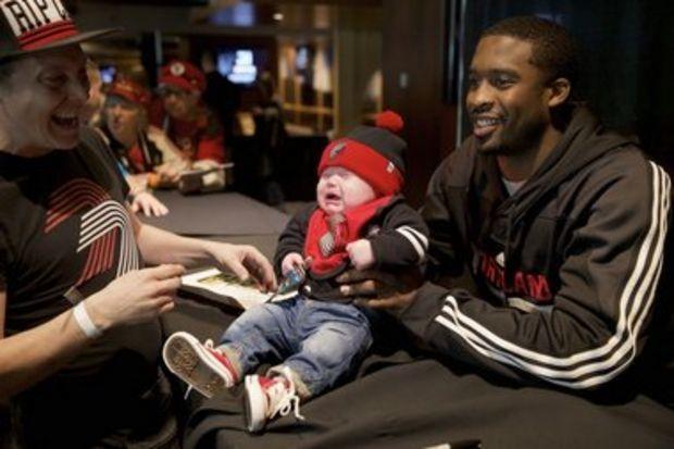 Portland Trail Blazers guard Wesley Matthews (2) has a way with children.