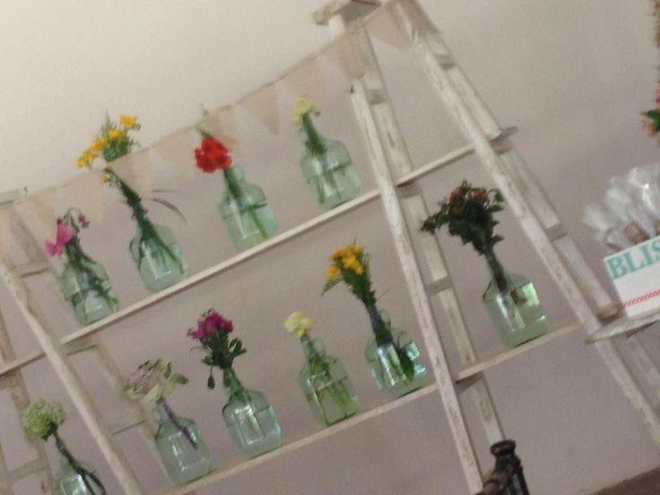 wood stairs, bottle, jars, flowers