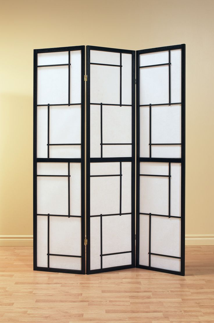 This three panel folding screen can be used as a room divider to enhance the ambiance and add a touch of flair. With its black, solid wood frame and geometric motif, this chic design will be an amazin