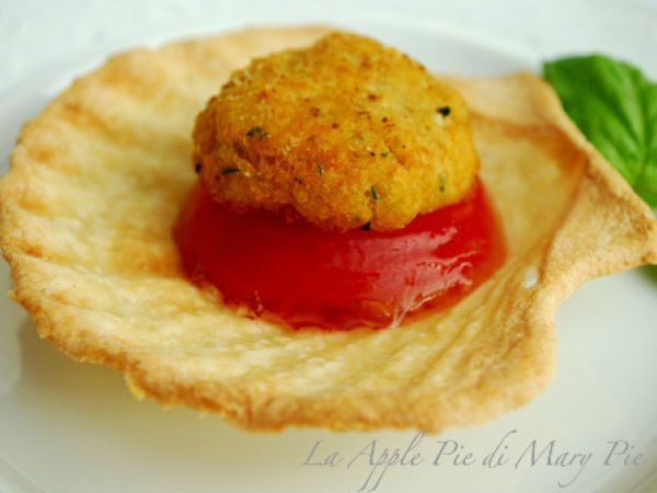 Ricetta Polpette di baccalà in conchiglie di briséé con gelatina di pomodoro da Marellla - Petitchef
