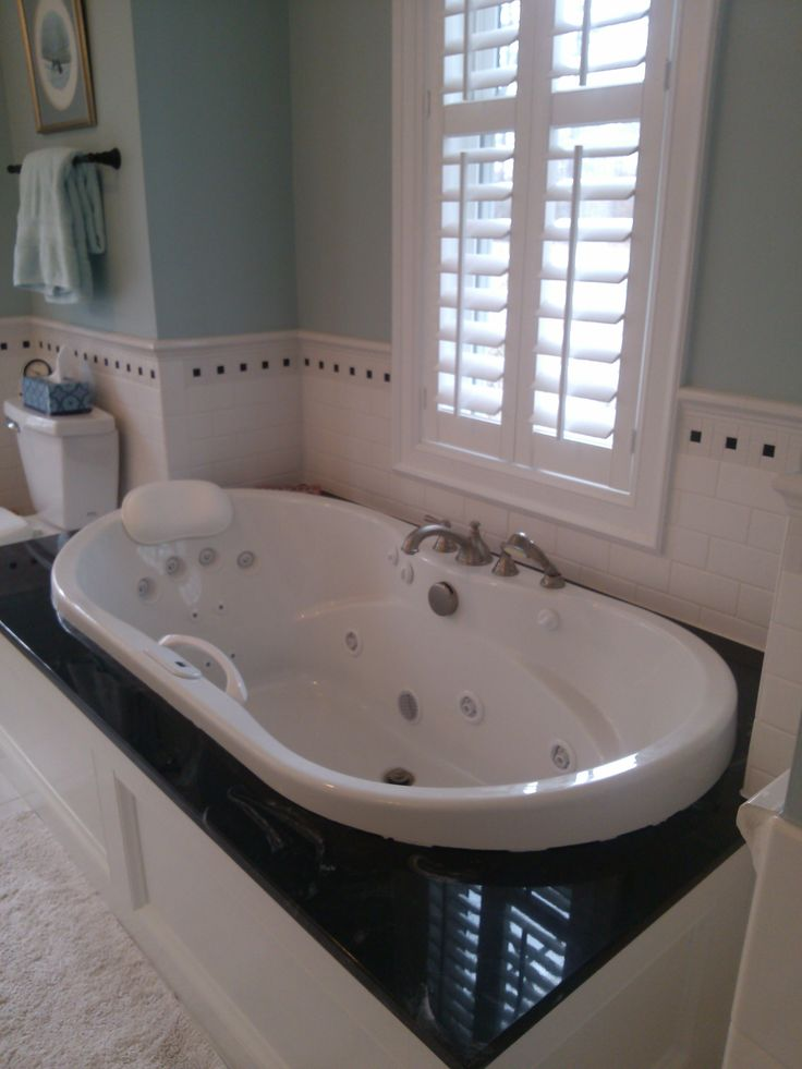 Relaxing In Luxury Black White Cultured Marble Surround Backdrops This Whirlpool Tub And Adds