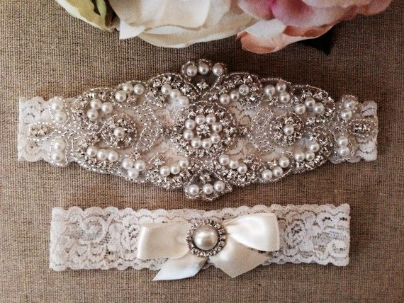 *Perfect for your special day!! **This beautiful set includes a gorgeous pearl and rhinestone crystal piece on the main garter. This piece measures about 6 by 2.5 and is attached to an ivory lace garter. The toss garter is accented with a single pearl and rhinestone piece and ivory satin bow. **PLEASE INCLUDE YOUR THIGH MEASUREMENT AT CHECKOUT. White lace and bow is also available Beautiful Wedding & Bridal Accessories. Custom Wedding & Bridal Accessories Online *Please check out...