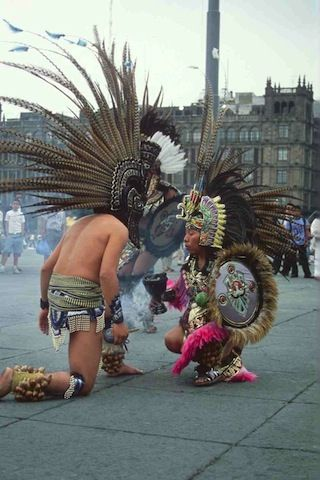 An aztec dance in Zocalo, Mexico City. Definitely one of the richest parts from their culture.