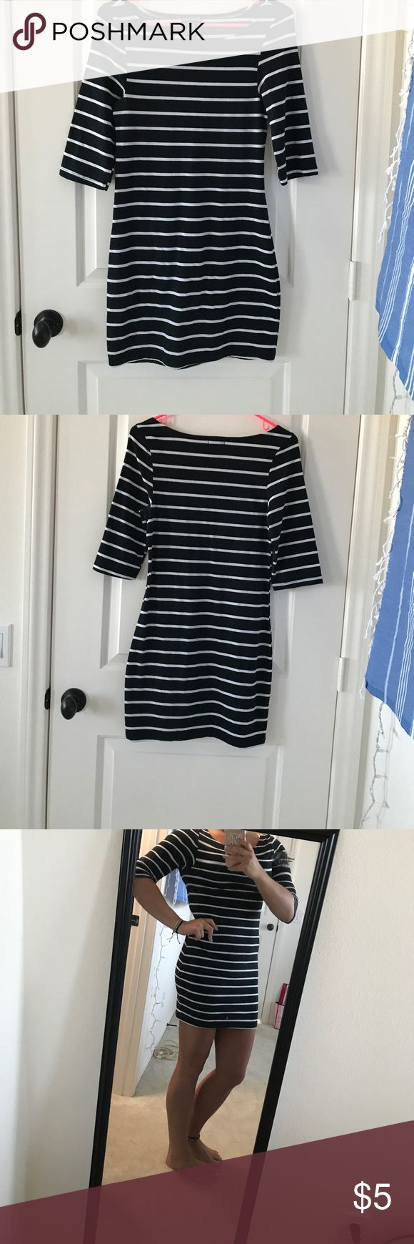 Wet seal black and white stripe dress Body con type dress. From wet seal. Black and white stripes. 3/4 sleeves. Only worn once. Wet Seal Dresses Midi