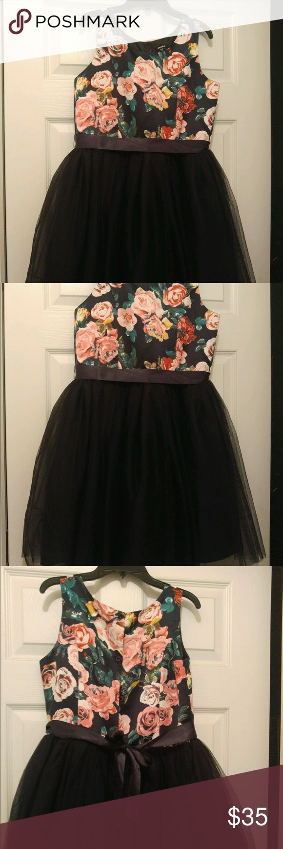 Floral navy girls dress Floral short girls short dress size 16, top is floral and bottom is navy tulle. Ribbon belt to tie in the back Zunie Dresses Formal