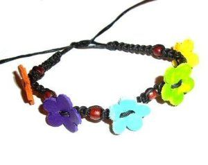 Black Friendship Bracelet / Surf Bracelet / Wristband Bracelet with Leather Flowers - Gifts for Girls Tribe leather. $3.99. Great for parties. Shipping to the USA 3 to 6 days from England. Other colors available. Best seller in England