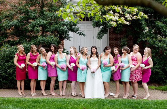 Bridesmaids in blue and honorary bridesmaids in pink! Only the blue ones stand up with you at the altar, but they all get to be in pictures! love it!