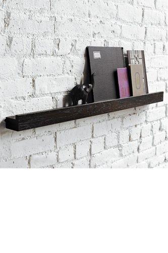 shelf on white brick wall