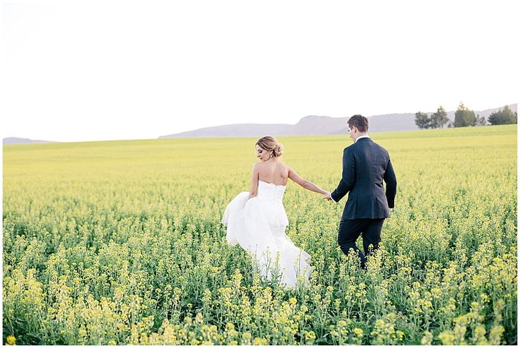www.vanillaphotography.co.za | Durban wedding photographer, Durban wedding venue, Crystal Barn wedding venue, rustic wedding venue, boho venue, bridal shoot, bride & groom, navy suit, lace, strapless, peplum bridal gown, loose updo, yellow field of flowers.