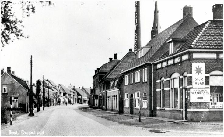 Best,  Dorpstraat (Hoofdstraat) in oostelijke richting, gezien vanaf de Stationsstraat. Op de achtergrond de schoorsteen van Tricot Best. Gevelreclame van Ster Tabak en Nationaal Spaarfonds. 1935 - 1945