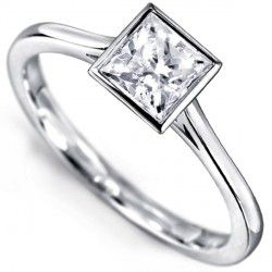 R1D033 - Fine Square Bezel Set Princess Solitaire Ring. A Princess cut diamond solitaire engagement ring with a fluted, fine, full bezel setting and narrow tapering shoulders.
