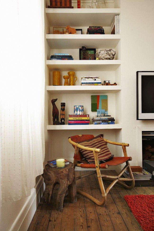 wood floors, fuzzy rug, and white built-in shelves