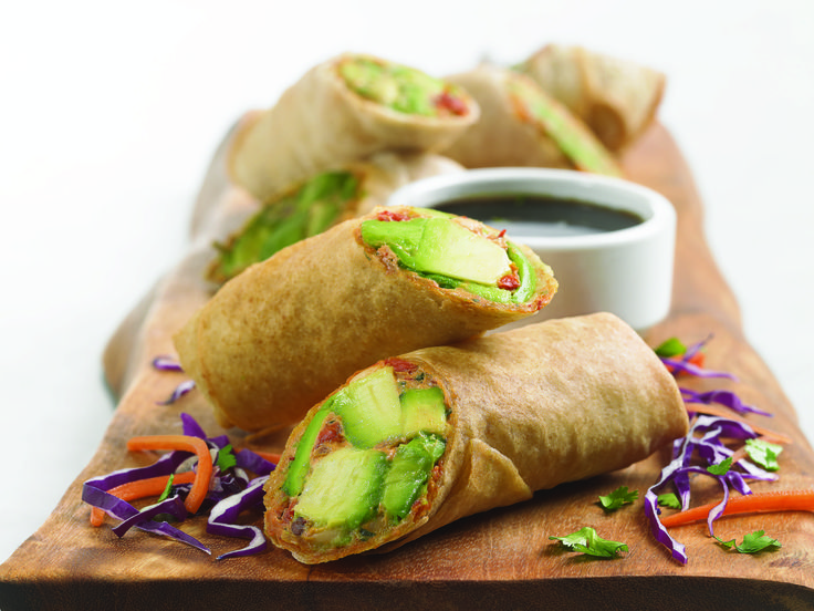 Avocado Egg Rolls - A blend of avocados, cream cheese, sun‑dried tomatoes, red onions, cilantro, chipotle peppers and spices. Served with a sweet tamarind sauce.