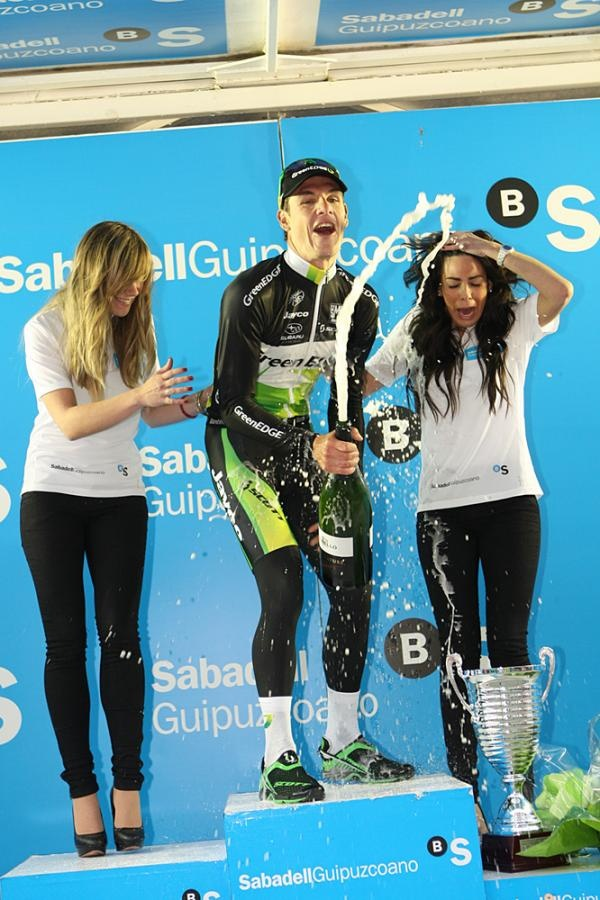 GreenEdge's Daryl Impey celebrates his win at stage 2 at the 2012 Vuelta Ciclista al Pais Vasco much to the dismay of the podium girls.