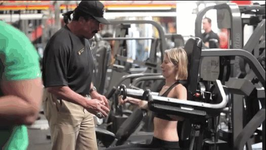 Arnold dressed up as a Gold's Gym employee in Venice, Calif., to promote health and fitness as well as raise money for after-school programs around the United States. | Arnold Schwarzenegger Went Undercover As A Trainer At A Gold's Gym