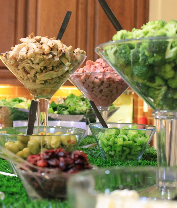 Diy Salad Bar for a party. Guests will enjoy putting their own salad together. Love the cute cocktail glasses, adds some fun !