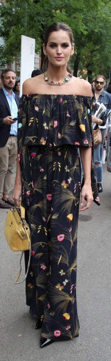 Who made Izabel Goulart's floral off the shoulder jumpsuit and yellow handbag?