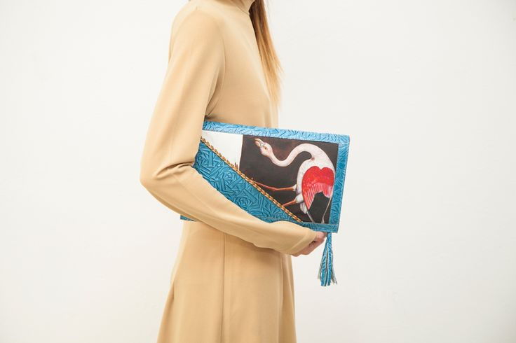 Turquoise clutch bag with a flamingo on the front! Get more like this at www.themanysides.com