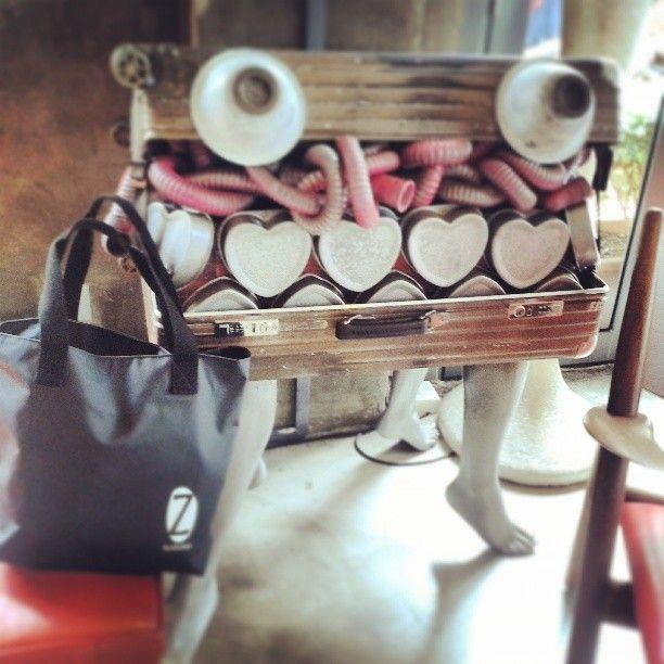 Z tote bag beside an industrial glam artwork