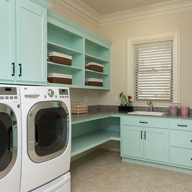I LOVE this laundry room! The double shelf/counter, the open-shelf cabinets, the color.... I want a pretty, functional laundry room!