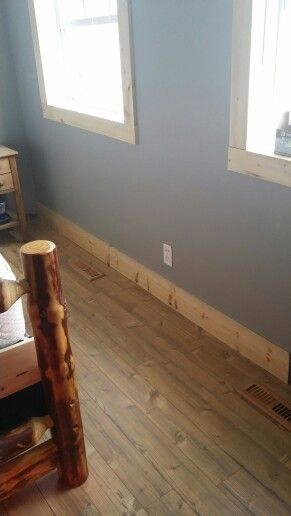 Natural pine baseboards and trim.
