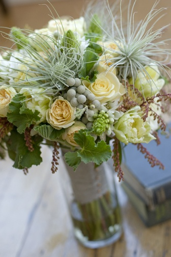 Bouquet of green tulips, andromeda, yellow garden roses, grey brunia, Star of Bethlehem, geranium and tillandsia