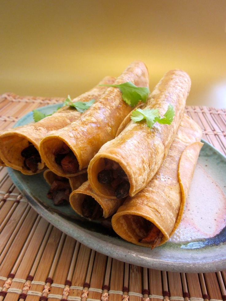 Black bean & sweet potato taquitos .. baked! Top 'em with a dollop of...