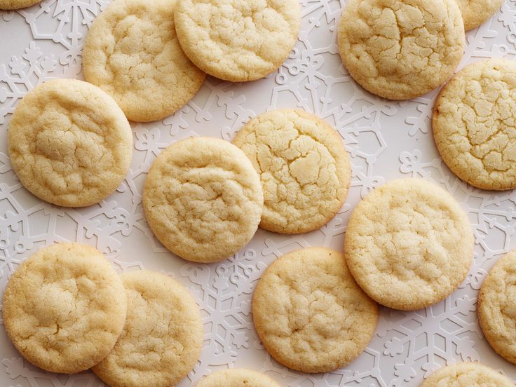 Chewy Sugar Cookies : Recipe courtesy of Food Network Kitchen  This version of the sugar cookie has a slightly crispy edge and a super-chewy center, thanks to increasing the sugar and baking at a higher temperature. Roll the cookies in colored sugar instead of granulated for a sparkly upgrade.