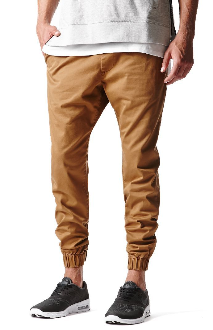 An alternative to men's denim jeans and chinos. The Chino Joggers pair up classic chinos with an elastic, drawstring waist as well as banded elastic cuffs at bottom.    Solid colored chino joggers
