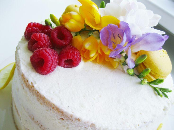Fluffy raspberry-lemon cake with lemon curd and macaroons.