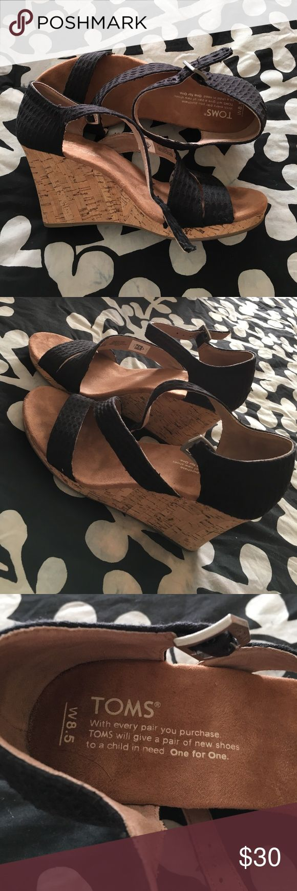 Toms wedges Black and cork Toms wedge sandals. Size 8.5. Worn maybe three times. Toms Shoes Sandals
