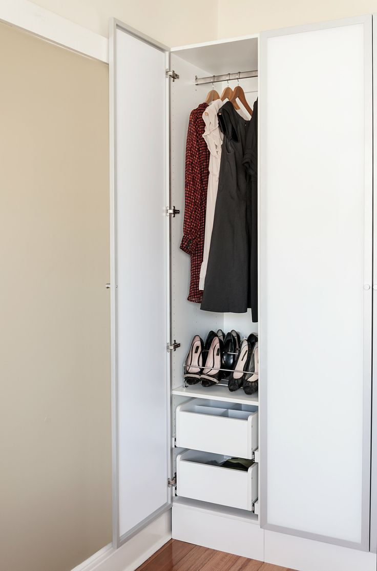 White wardrobe cabinet, drawers and suit hanger. #wardrobeinterior #flatpackwardrobe #wardrobeshelves #wardrobedrawers #whitewardrobe