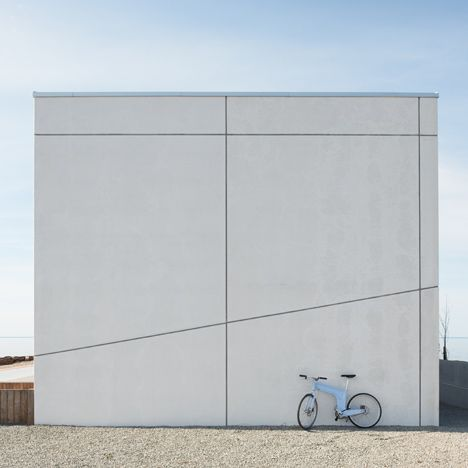 Swedish architects Claesson Koivisto Rune have completed a house on the coast of a Baltic island, with grey sealant drawing graphic lines across the white concrete facade.