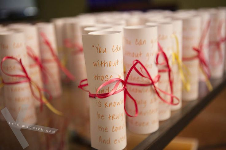Artistic way of displaying the ceremony booklet. Wedding photography by Kris Mc Guirk.