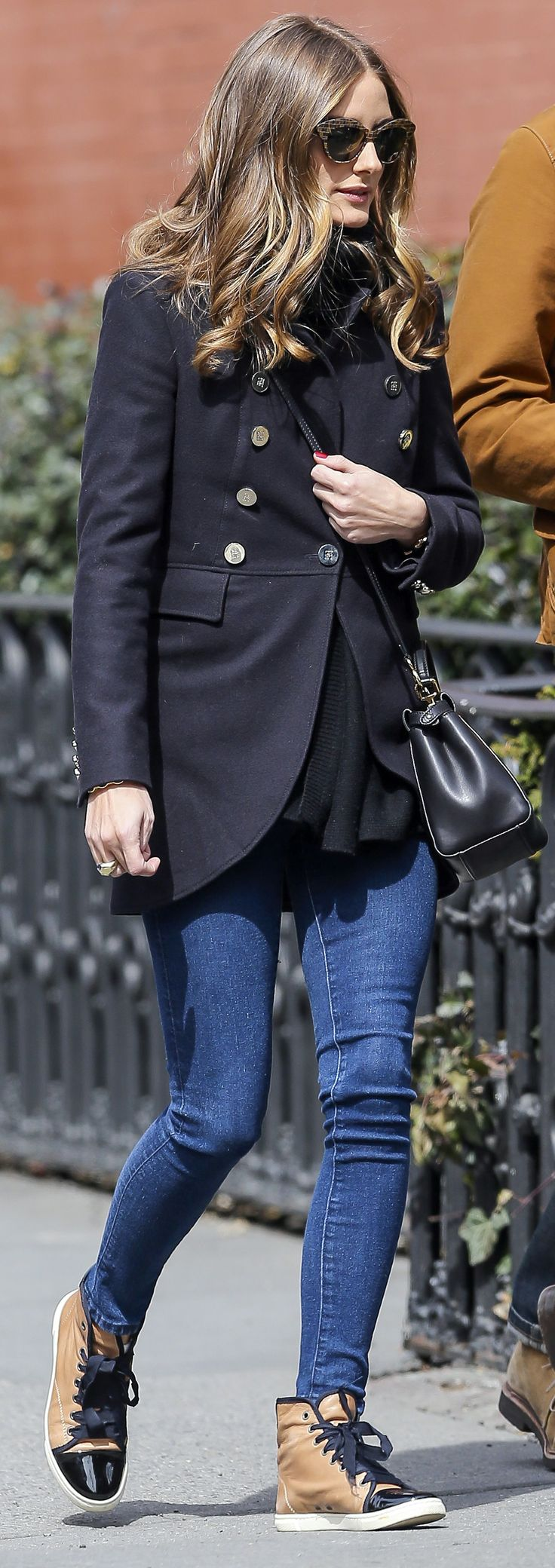 Olivia Palermo finishes skinny jeans and a military-inspired coat with Lanvin cap-toe sneakers