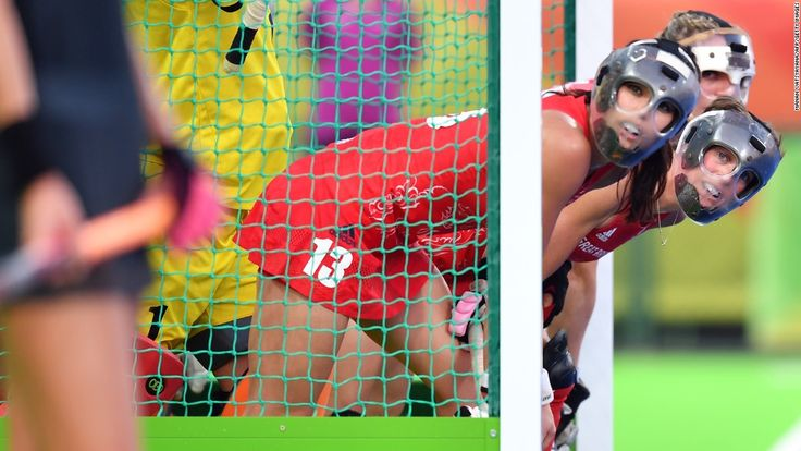 British field hockey players defend their goal during the gold-medal match…