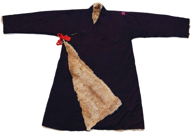 Tibetan Khampa man's coat (Chuba), hand woven fine cotton twill, Lynx fur lining, silk ties.  (Few small holes and small patch.)  Kham, Tibet 20th C., Length 140cm.