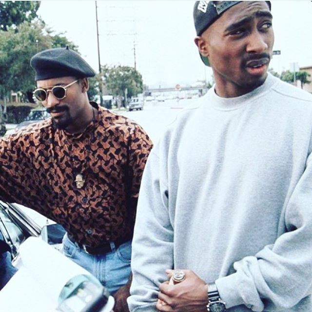Director John Singleton and actor Tupac Shakur on the set of 'Poetic Justice'…