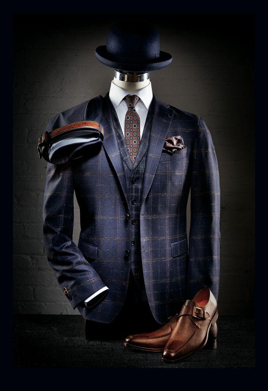 Van Gils 3-Piece Broken Suit: $1098 Van Gils Textured Tie: $100 Van Gils Silk Pocket Square: $30 Van Gils Bowler Hat: $115 Bill Lavin Belt: $228 Giulio Moretti Pebbled Monk Shoes: $398