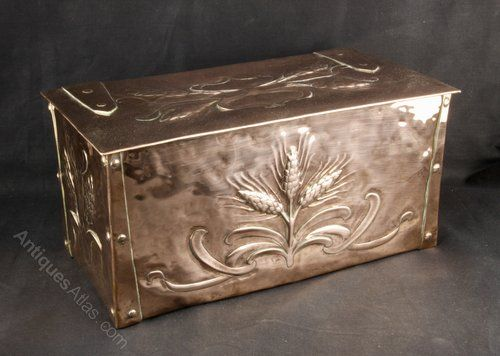 An Arts and Crafts rectangular copper box, decorated with wheat sheaves and strap work hinges. Dating to circa 1900 it is in reasonable condition, commensurate with age, with slight wear to the extremities and a couple of restored holes to the top where the copper had been rubbed through.