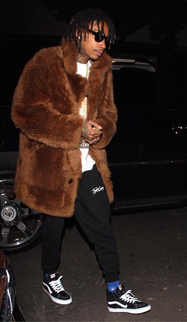 Wiz Khalifa Rocks Coach 1941 Reversible Shearling Fur Coat, Gosha Rubchinskiy Socks And Vans Sneakers