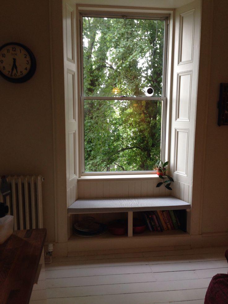 Cookbooks under window seat