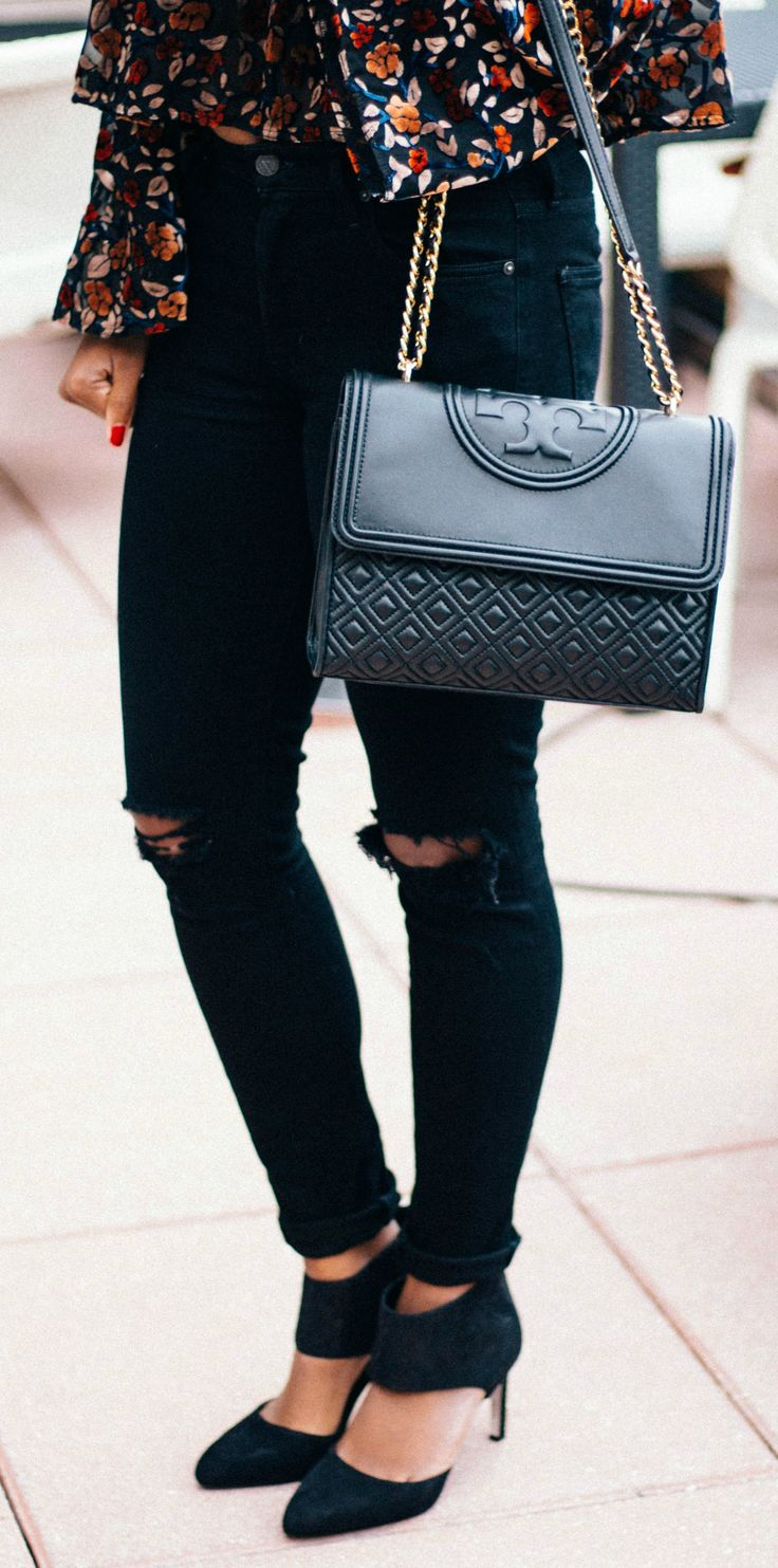 Destroyed denim, Tory Burch bag, and comfy heels -- the perfect Girls Night Out outfit!