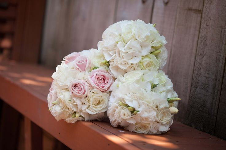 Soft pink and white lisianthus, roses, and hydrangea - Romantic wedding flowers made by Amy's Flowers